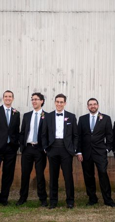 The handsome groom and his groomsmen! {Blume Photography}  I like the business suits and the grooms tie is different than the groomsmen