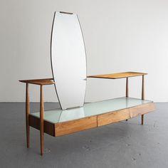 Martin Eisler, Brazil  Rare three-drawer vanity in jacaranda with reverse painted glass top and mirror.