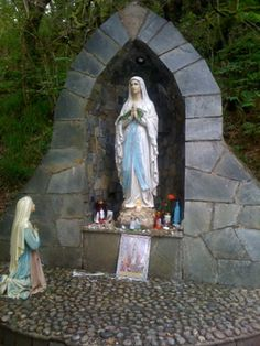 Altar at Doon well, Northern Ireland - love the praying saint!