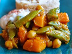 Moroccan style stew with onion squash, chickpeas and sugar snap peas