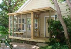 This Catio, from The Cat Carpenter, is really just a twist on a screened porch, with slightly larger mesh and shelves for kitties to sit on and look around. Cats can access the catio through a window into the home, humans through the screened door. Diy Cat Enclosure, Outdoor Cat Enclosure, Reptile Enclosure, Cat Run, Bois Diy, Cat Condo, Pet Furniture, Furniture Outlet, Luxury Furniture