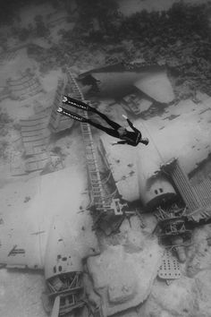 Wow. Swimming in water, looks like he/she is free falling in air. Beneath...submerged planes.