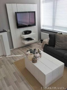 tv meubel steigerhout -  Vb zwart vlak om tv niet te doen opvallen + teller weg te steken zonder kast...