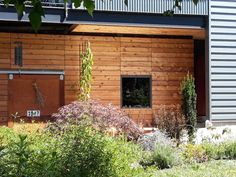 In this photo, our customer used our Knotty Western Red Cedar dimensional boards to create a rustic, modern rain screen facade. Cedar Cladding, Cedar Siding, Exterior Siding, Western Red Cedar Lumber, Port Orford Cedar, Building Materials, Facade, Pergola, Outdoor Structures