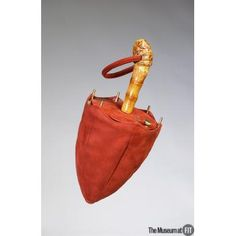 Medium: Burgundy suede with bamboo and gold-tone metal  Date: 1950s  Country: USA