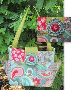 Handmade Bucket Bag, Handmade purse, handbag, shoulderbag, Tote Bag, Diaper Bag. Verona Fabric. $95.00, via Etsy.