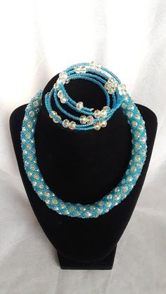 This glamorous tubular necklace set that comes in blue and white with bracelet that fit any occasions especially an anniversary, and a gift set for loved ones. Necklace Set, Beaded Necklace, Crystal Beads, Crystals, Hand Bags, Blue And White, Glamour, Bracelets, Handmade