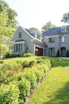 A stucco exterior and simplified windows are a contemporary take on traditional style.