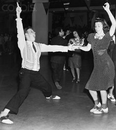 Original caption: 9/23/39-New York: Alfred Schock and Evelyn Stein are going to town in a big way during the jitterbug session that marked the opening of the Mardi Gras swing casino at the New York World's Fair. The casino is free to all fair goers -- all rug-cutting is strictly on the house.