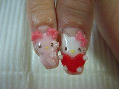 Hello Kitty nails. I think they're fake nails.