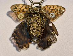 Real butterfly wings in resin by Shelia Daniels