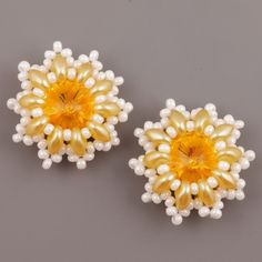 DIY - Earrings with Twin Beads The material on one flower 1 pcs Swarovski Elements Rivoli 14 mm in color Sunflower 24 pcs yellow SuperDuo best white pearl beads TOHO beads or size 11