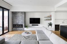 A refined material palette comprised of timber and a Portsea marble fire place. Living Room Decor Fireplace, Fireplace Tv Wall, Modern Fireplace, Living Room Tv, Fireplace Design, Living Room Kitchen, Interior Design Living Room, Home And Living, Living Room Designs