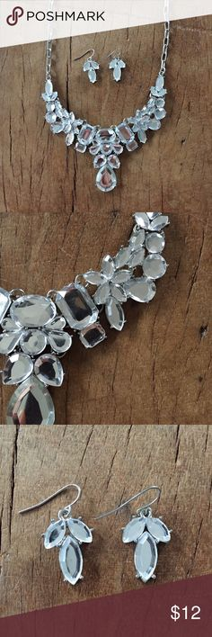 """Statement Necklace & Earring Set Crystal statement necklace with matching earrings in silver. Necklace adjusts 18-21"""". Worn once for a wedding on New Years Eve. Charming Charlie Jewelry Necklaces"""