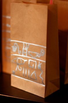 weelife: Egyptian Themed Birthday Party; using hieroglyphs to decorate the goodie bags!