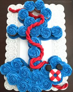 This anchor cupcake cake is just gorgeous made by N and L Sweet Treats! It was made for a baby shower with a mickey mouse theme as you can see with the little floatie in the bottom corner. You will need 26 blue frosted cupcakes to make it. Pull Apart Cupcake Cake, Pull Apart Cake, Baby Shower Cupcakes, Baby Boy Shower, Birthday Cupcakes, Ladybug Cupcakes, Kitty Cupcakes, Snowman Cupcakes, Blue Cupcakes