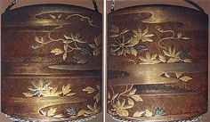 Case (Inrô) with Design of Clematis Vine on Bamboo Lattice  Nankai (1677–1751)  Period: Edo period (1615–1868) Date: 18th century Culture: Japan Medium: Lacquer sprinkled with gold and silver makie, and foil; Ojima: floral scrolls in openwork; silver and silver wire; Netsuke: chrysanthemum medallion; ivory