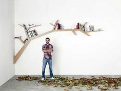 Simple and Stylish Branch-Shaped Wall Bookshelf - This stylish bookshelf with simple line is one of innovative and creative furniture design from French designer Olivier Dolle. This branch bookshelf looks good to be applied in any room, but it will b