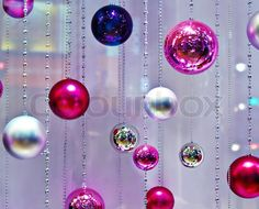 Image of 'Pink Holiday Background with glass bauble Christmas Ornaments'
