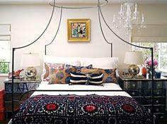 Suzani and ikat pillows. suzani bedspread. interior design. bedroom design