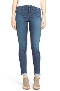 Ultra-slim from the waist to the ankle, these medium-wash skinny jeans feature a vintage-inspired high rise for a lean, leg-lengthening silhouette.