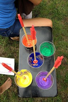 Dip suction-cup arrows in paint to take backyard archery to the next level. | 29 Dollar-Store Finds That Will Keep Your Kids Busy All Summer