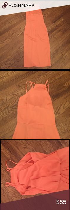 NWT ASOS Dress Peachy/orange/pink color high necked asos dress.  Brand new with tags.  Zips up side.  Gorgeous dress with fun straps.  Back is super cool!  Make me an offer!! ASOS Dresses