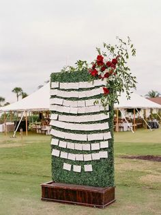 Escort card display on greenery wall with red floral arrangement as decoration Simple Wedding Decorations, Simple Weddings, Reception Decorations, Real Weddings, Wedding Ideas, Reception Ideas, Wedding Pictures, Wedding Colors, Wedding Planning