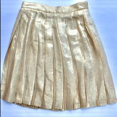 Gianni Versace Couture metallic skirt. Size 40 IT This beautifully handcrafted Versace metallic skirt is an amazing find! Vintage couture skirt, a few minor pulls in fabric. Era 1990's. Authentic Gianni Versace brand, made in Italy. 92% silk, 8% polyester. Size 40 IT (Eu) Versace Skirts
