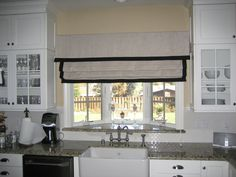 Roman shade with banding and valance.