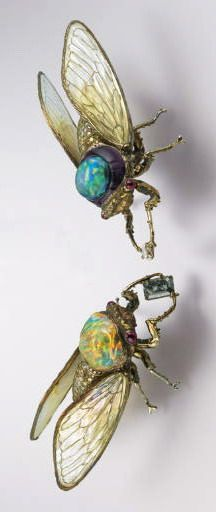 A PAIR OF DELICATE MULTI-GEM AND COLOURED DIAMOND BROOCHES, BY WALLACE CHAN  Each designed as a cicada holding a rectangular-cut grey or marquise-cut brown diamond, set with an oval-shaped fire opal or black opal with a carved amethyst surround, to the cabochon ruby eyes and brilliant-cut yellow to brown coloured diamond body, extending light green and blue crystal and mother-of-pearl wings with titanium veins, mounted in titanium, 7.5 and 8 cm long