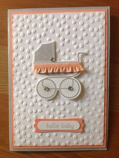 Baby pram stampin up card for baby shower. Something for baby stamp set, crisp cantaloupe and grey ink, crisp cantaloupe ruffle ribbon and decorative dots embossing folder.