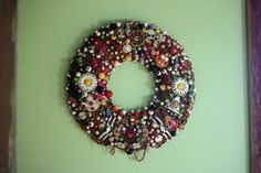 Kitschy Wreath / or Fabulous Jewelry Wreath... with tutorial.  Wood base (or heavy cardboard), with flat-back foam circle attached (for pinning jewels with straight-pins.  ***Notes: This wreath will probably be quite heavy, so a wood base is necessary.  I highly recommend dipping pins in white glue before pinning object to wreath.