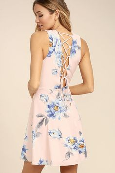Dance gracefully through the flowers in the Garden Walk Blush Pink Floral Print Lace-Up Skater Dress! Blue, white, and yellow floral print adorns blush pink woven fabric as it shapes a sleeveless, princess seamed bodice with a surplice neckline and fun lace-up back. Fitted waist flows into a full skater skirt. Hidden back zipper.