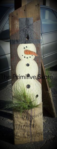 Old Barn Board & Burlap Bag...re-purposed into a primitive snowman decoration.  Paint a snowman onto the wood, cut a burlap bag in half & staple to the bottom to create a pocket and add some pine branches.  So awesome...The Primitive Skate.  Instructions included. #gardening