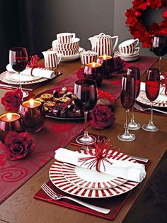 Christmas Table Ideas Using Red and White: Ruby red glasses are a fabulous way to bring color to your holiday table.