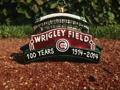 The limited-edition hand crafted glass and painted Christopher Radko  Wrigley Field 100 Christmas Ornament. All proceeds benefit charity.