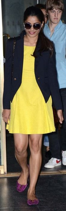 Who made Frieda Pinto's gray sunglasses, yellow dress, pink ballet flat shoes, and handbag that she wore in New York? Dress – Rachel Roy  Shoes and purse – Roger Vivier