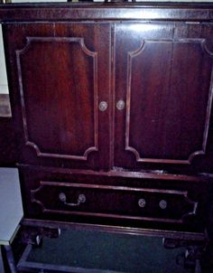 Mahogany 2-Door and 2-Drawer Cupboard. Butterfly doors fold outwards.