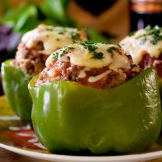 A green pepper stuffed with quinoa and ground turkey, with melted mozzarella on top.
