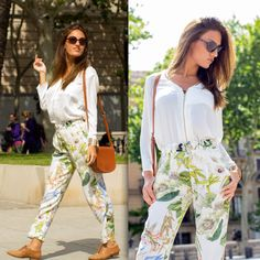 White blouse on leaf printed trousers
