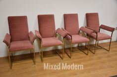 """A set of four modern dining chairs made of brass frames and pink upholstered seats. Frames show signs of wear. Upholstery in great-excellent condition. Seat height is 18"""". 25.25"""" wide. 23"""" deep. 29"""" tall. Shipping typically takes 2-8 weeks. Please include phone number with your order. 