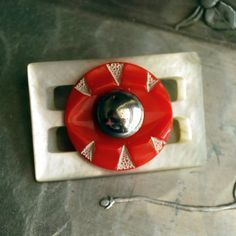 repurposed vintage belt buckle and button. neat idea for a brooch!