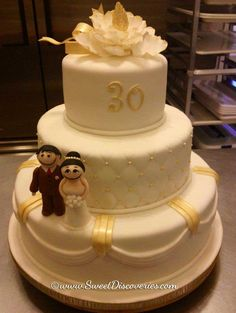 "30 years of ""wedded bliss""!  I would eat this cake!  I had red roses and gourmet dipped strawberries.  Thank you, Dale and Paige...:)"