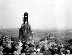 Building Seattle literally meant moving mountains. 1930 A crowd gathers to witness the last shovel of dirt and the completion of the second Denny regrade.