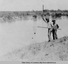 Two boys fishing for crabs in Saint Bernard Parish Louisiana in the 1930s :: State Library of Louisiana Historic Photograph Collection