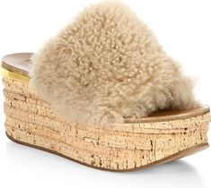 """Chloe Women's Shoes in Pink Sand Color. Fluffy top set on textured cork platform. Cork platform, 2"""" (50mm).Shearling/leather upper. Open-toe. Slip-on style. Leather lining. Rubber sole. Fur type: Dyed shearling. Fur origin: Spain. Made in Italy."""