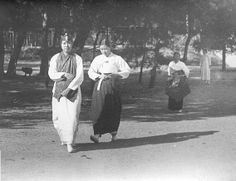 """Photo by Jung hae chang, 1928. 'Where are you going?"""" Ladies are going out."""