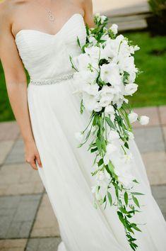Stunning & Ultra Sophisticated White Cascading Arm Sheaf Bridal Bouquet Showcasing: Gladiolus, Lisianthus, Dendrobium Orchids (Bud Stage), Freesia, & Greenery/Foliage