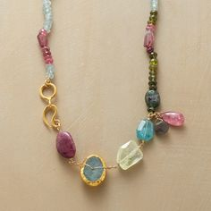 """ACROSS THE SPECTRUM NECKLACE�--�Nava Zahavi�collects gems of aquamarine, moonstone, sapphire, apatite and pyrite in cool hues for this handmade gemstone necklace, then warms the strand with pink tourmalines and 24kt gold. 24kt gold vermeil hook clasp. Exclusive. Approx. 18""""L."""